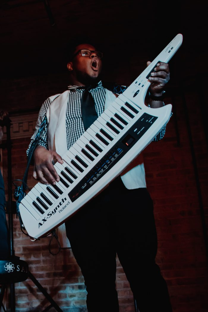photo of a piano player rocking the keytar | Howl2GO | Event Entertainment | Live Band | Dueling Pianos | Cover Band